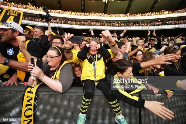 A young Tigers fan reacts and celebrates after the 2017 AFL Grand Final match between the Adelaide Crows and the Richmond Tigers at Melbourne Cricket...