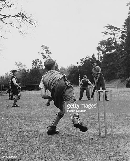 Young Tim Cowell bowls in a cricket game played by pupils at the Hinwick Hall residential school in Bedfordshire The school which is run by the...