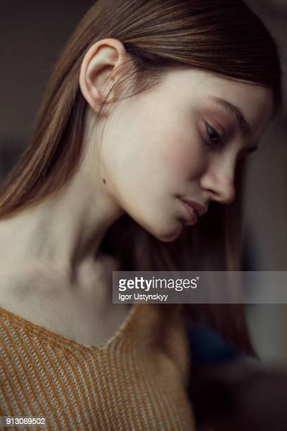 Young tired woman looking down