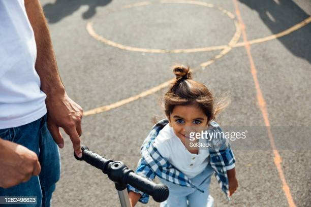 young toddler boy in schoolyard - preschool child stock pictures, royalty-free photos & images