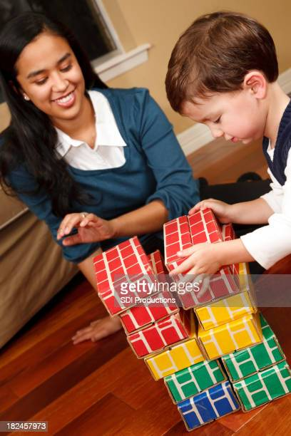 Young Toddler Building Blocks with his Mother or Nanny
