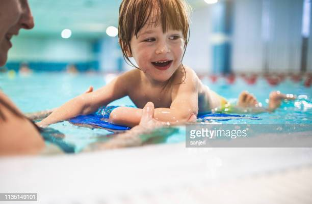 young toddler learning to swim - swimming stock pictures, royalty-free photos & images