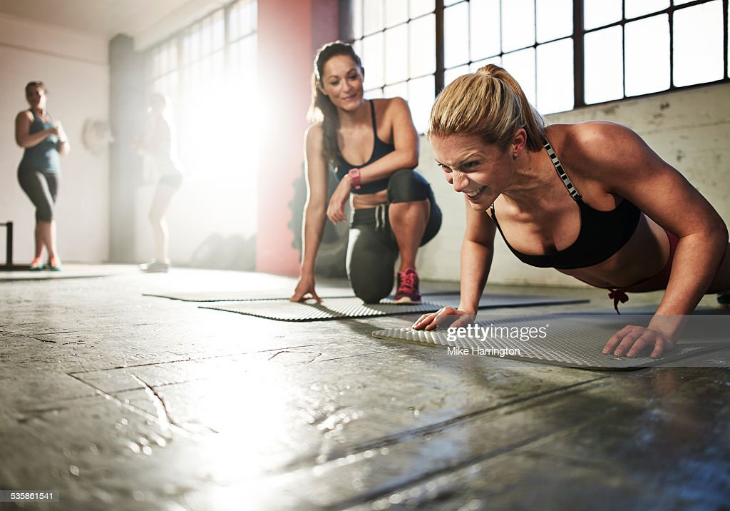 Young toned female working out in gym : Stock Photo