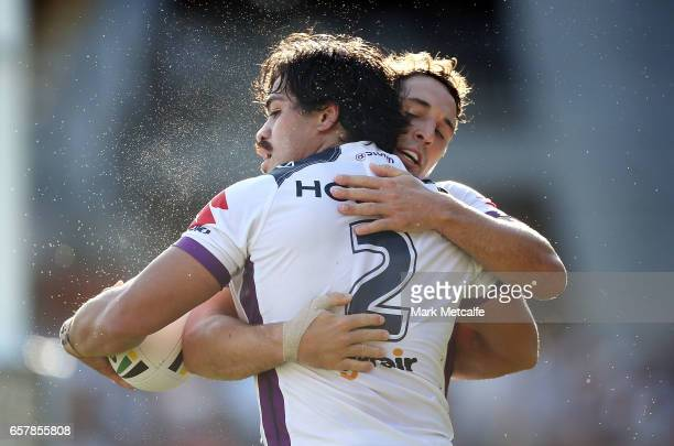 Young Tonumaipea of the Storm celebrates scoring a try with team mate Billy Slater during the round four NRL match between the Wests Tigers and the...