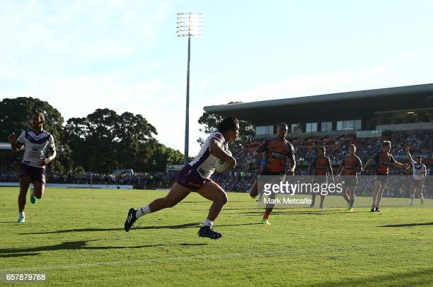 Young Tonumaipea of the Storm scores a try during the round four NRL match between the Wests Tigers and the Melbourne Storm at Leichhardt Oval on...