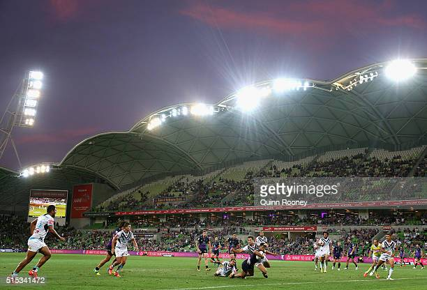Young Tonumaipea of the Storm scores a try during the round two NRL match between the Melbourne Storm and the Gold Coast Titans at AAMI Park on March...