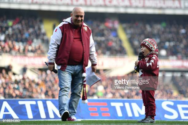 A young torino fan reads the formations during the Serie A match between Torino FC and Udinese Calcio at Stadio Olimpico di Torino on February 11...
