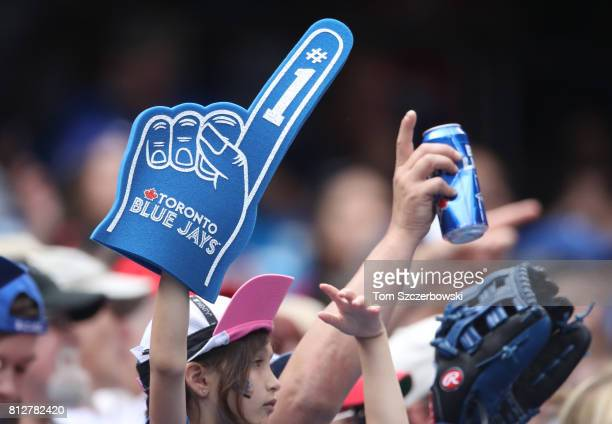 A young Toronto Blue Jays fan waves a foam finger during MLB game action against the Houston Astros at Rogers Centre on July 9 2017 in Toronto Canada