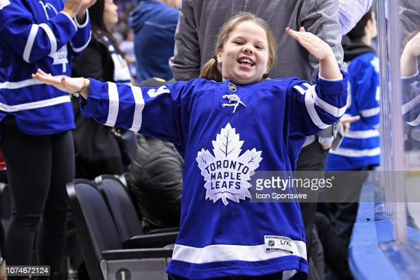 A young Toronto Maple Leafs fan cheers after a goal during the regular season NHL game between the Florida Panthers and Toronto Maple Leafs on...