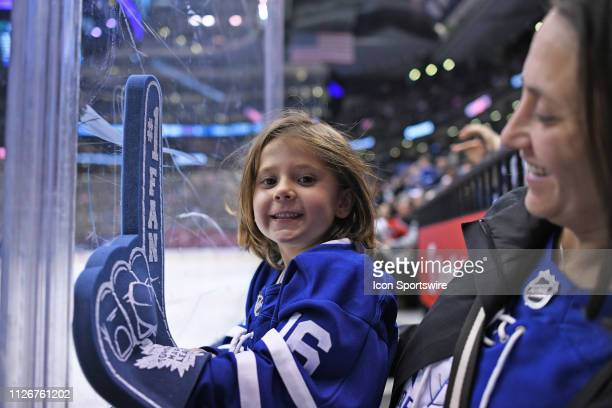A young Toronto Maple Leafs fan cheers during the regular season NHL game between the Washington Capitals and Toronto Maple Leafs on February 21 2019...