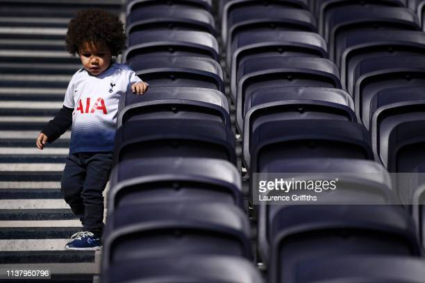 A young Tottenham fan takes their seat inside the new stadium ahead of the U18 Premier League between Tottenham Hotspur and Southampton at Tottenham...