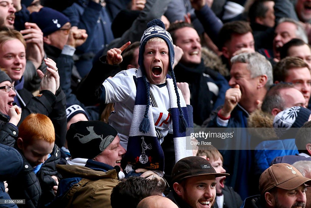 A young Tottenham Hotspur supporter reacts after Harry Kane of Tottenham Hotspur scores his team's second goal during the Barclays Premier League match between Tottenham Hotspur and Arsenal at White Hart Lane on March 5, 2016 in London, England