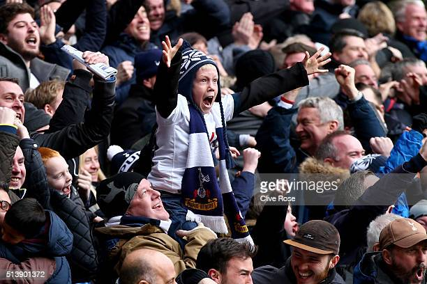 Young Tottenham Hotspur supporter reacts after Harry Kane of Tottenham Hotspur scores his team's second goal during the Barclays Premier League match...