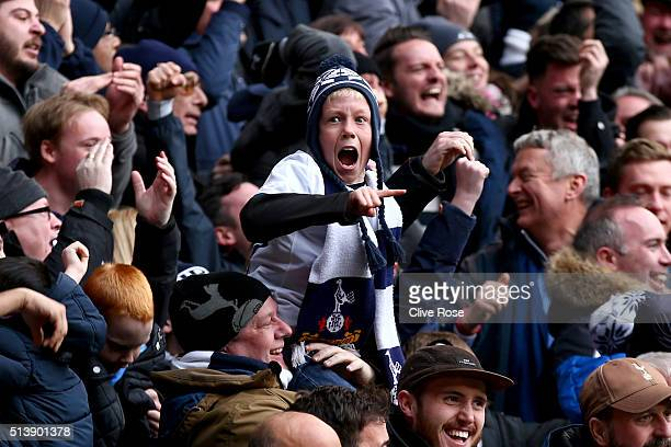 A young Tottenham Hotspur supporter reacts after Harry Kane of Tottenham Hotspur scores his team's second goal during the Barclays Premier League...