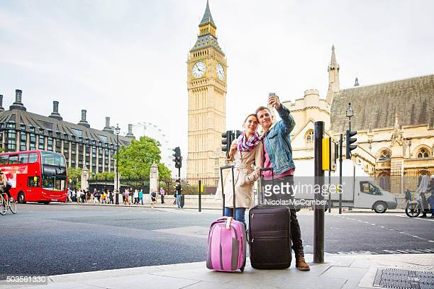 Young tourist couple shoots selfie Big Ben London UK