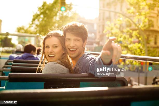 Young Tourist Couple Sightseeing on a Bus