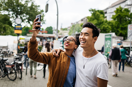 Young Tourist Couple Taking A Photo Of Themselves - gettyimageskorea