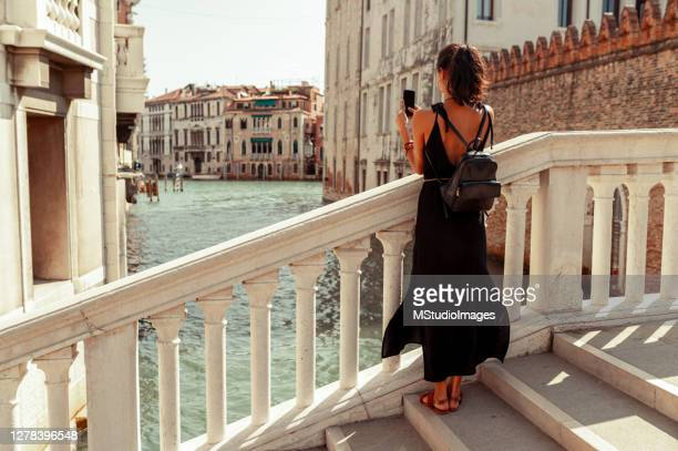 young tourist enjoying venice - venice italy stock pictures, royalty-free photos & images