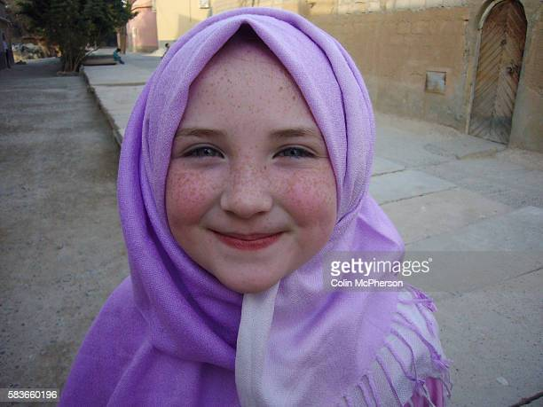 A young tourist girl dressed in a traditional headscarf in Taroudant Taroudant in the Sous Valley was situated east from Agadir on the road to...