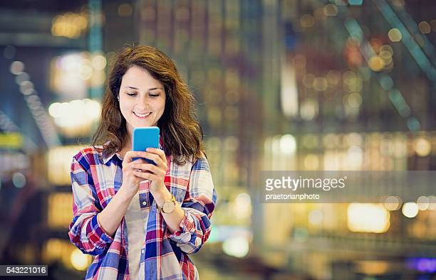 young tourist girl is texting in tokyo - transportation building type of building stock photos and pictures