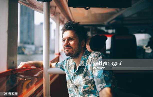 young tourist riding on the bangkok ferry boat - candid stock pictures, royalty-free photos & images