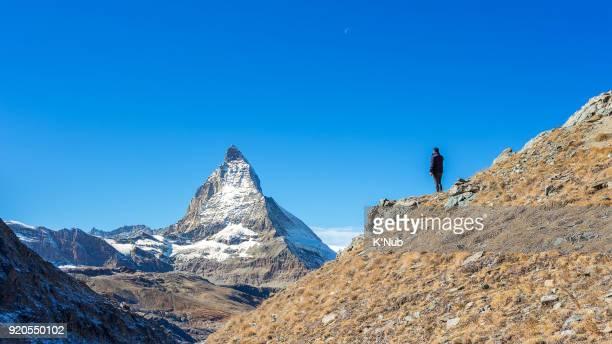 young tourist stand on the peak and look at Matterhorn, Zermatt, Switzerland