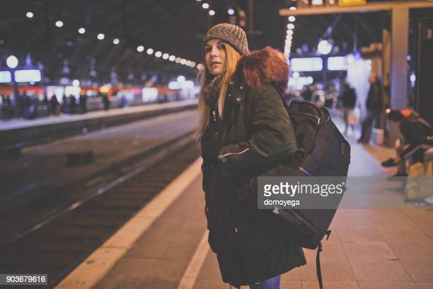 young tourist with a backpack on the railroad station in cologne - railway station stock pictures, royalty-free photos & images