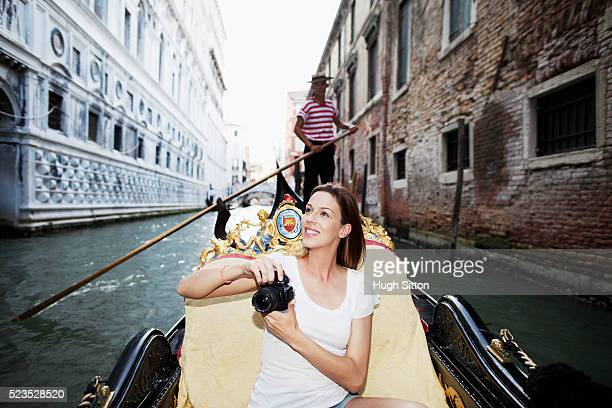 young tourist woman on gondola - hugh sitton stock pictures, royalty-free photos & images