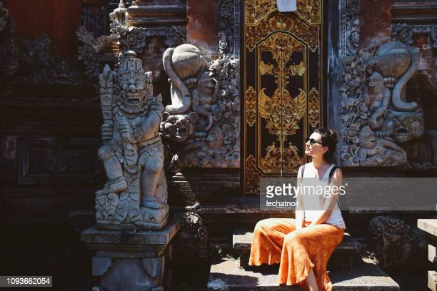 young tourist woman relaxing by the balinese temple - philosophy stock pictures, royalty-free photos & images
