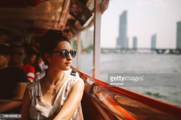 young tourist woman riding on the bangkok ferry boat - passenger craft stock pictures, royalty-free photos & images