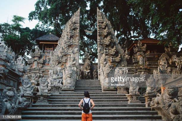 young tourist woman traveling in bali, indonesia - hinduism stock pictures, royalty-free photos & images