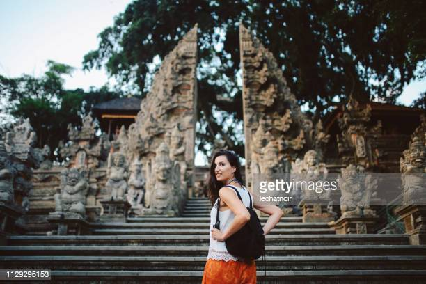 young tourist woman traveling in bali, indonesia - indonesian culture stock pictures, royalty-free photos & images