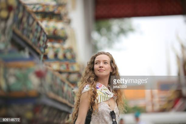 Young tourist woman visiting temple