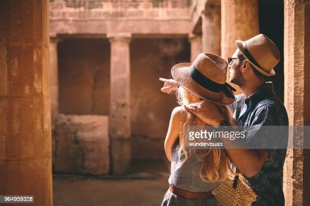 Young tourists couple doing sightseeing at ancient archaeological site