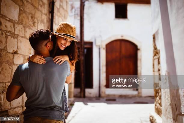 young tourists couple flirting and having fun in mediterranean village - isola di cipro foto e immagini stock