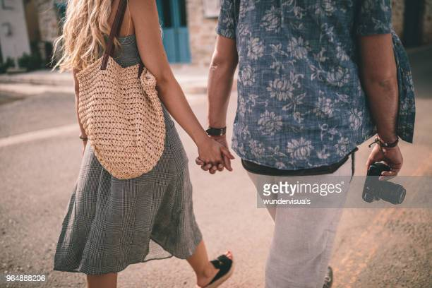 Young tourists couple holding hands on summer holidays in Europe