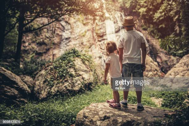 young tourists exploring jungle - ko samui stock photos and pictures