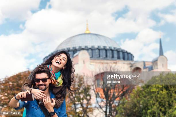 Young tourists in front of Hagia Sophia in Istanbul, Sultanahmet
