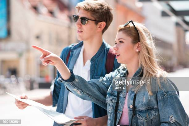 young tourists in town - thoroughfare stock photos and pictures