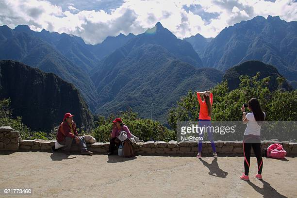 Young tourists takes pictures of themselves in Machu Picchu on July 17 2016