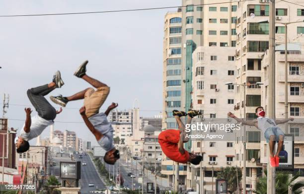 Young traceurs perform parkour in front of their houses following a full lockdown imposed on 24th August against the coronavirus pandemic after the...