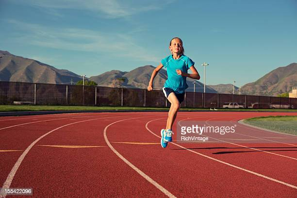 young track runner - atletiek stockfoto's en -beelden