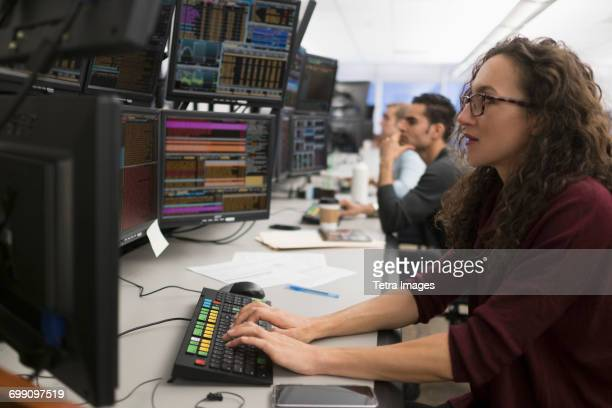 young traders analyzing computer data - trading floor stock pictures, royalty-free photos & images