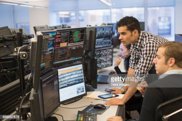 young traders analyzing computer data - traders stock pictures, royalty-free photos & images