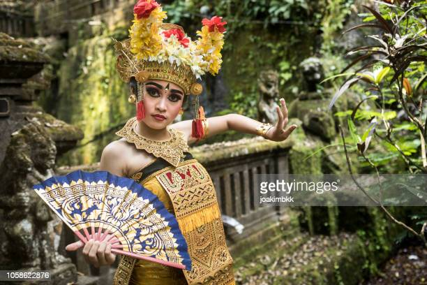 young traditional bali dancer in a bamboo forest - balinese culture stock pictures, royalty-free photos & images