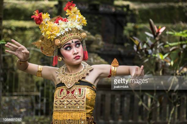 young traditional bali dancer in a hindu temple - bali stock pictures, royalty-free photos & images