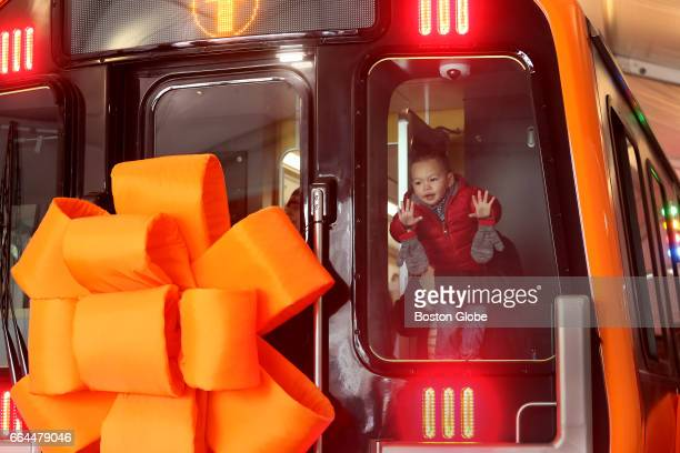 Young train enthusiast Clark Parena of Medford gets a close up view of the new Orange Line train mockup which is on display at City Hall Plaza in...