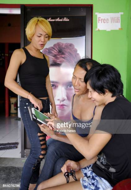 Young transgender people look for lovers through Internet social networking services in Yogyakarta Indonesia on Aug 19 2017 Lesbian gay bisexual and...