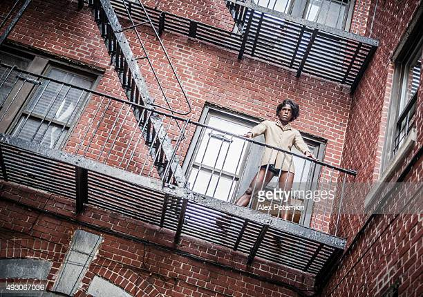 young transgender woman on the fire stair - black transgender stock pictures, royalty-free photos & images