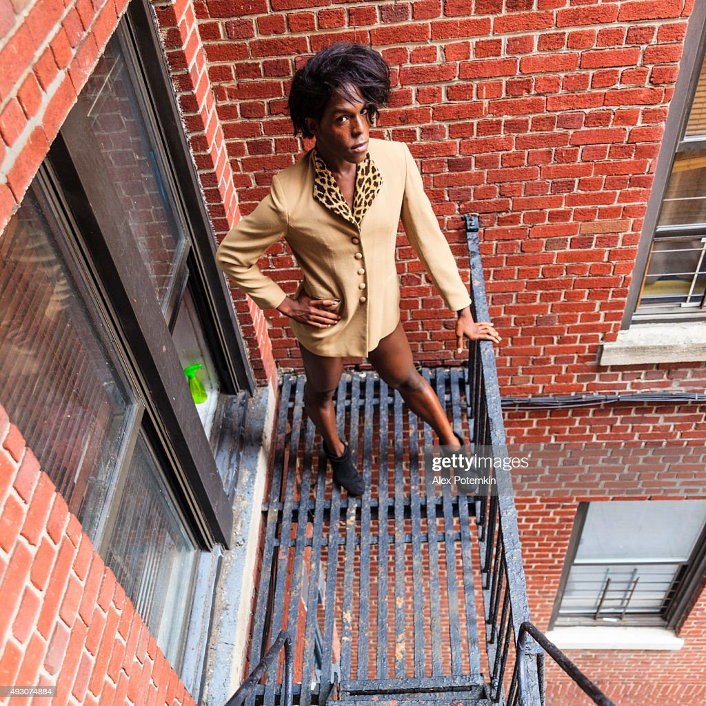 Young transgender woman on the fire stair : Stock Photo